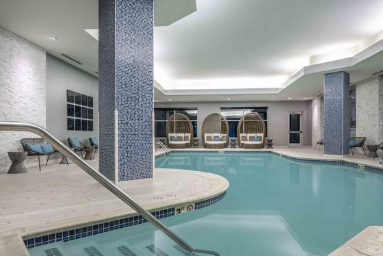indoor pool with lounge chairs
