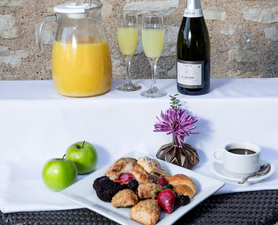 mimosas, fruit, and pastries