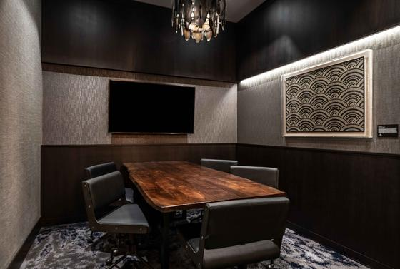 modern boardroom with long wooden table