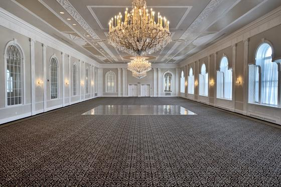 empty ballroom with a large golden chandelier