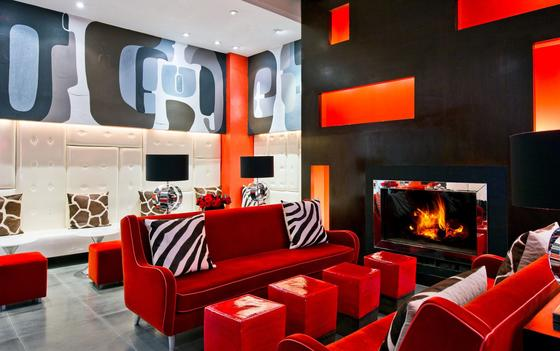 Colorful room with a red couch and wall art