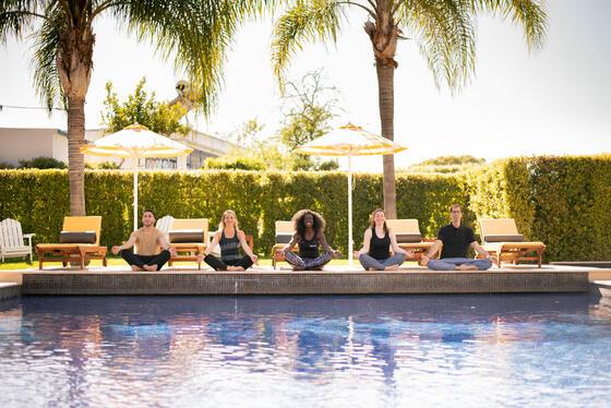 Pool side Yoga Event - The Magnolia Hotel