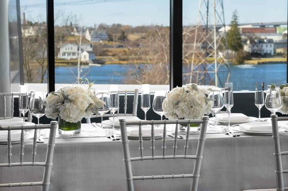 wedding tables next to window overlooking water
