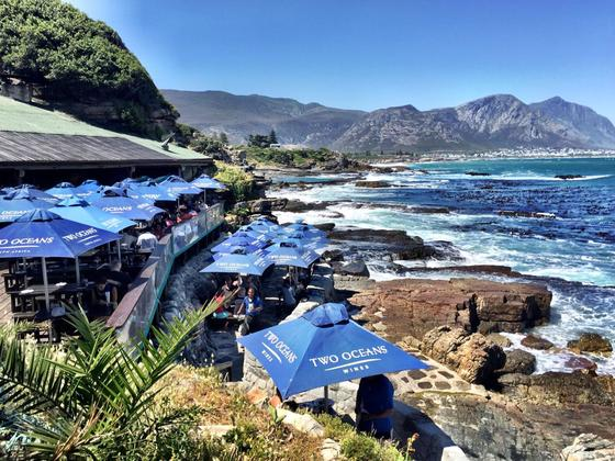 Bientang's Cave restaurant on the rocks by the sea in Hermanus