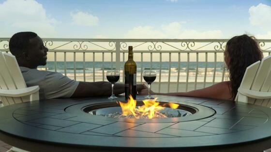 couple drinking wine near firepit