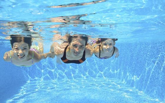 three girls swimming underwater