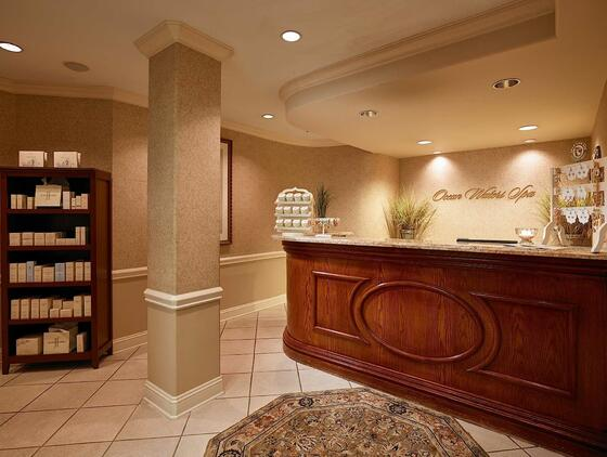 spa reception desk with products on shelf