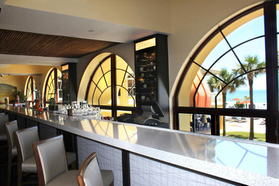 bar with bar stools and window views