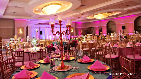 banquet hall with decorated tables and lighting