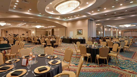 banquet hall with decorated tables and chairs