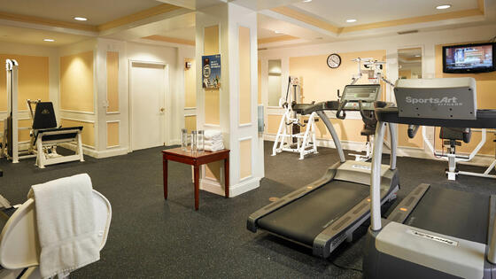 gym with treadmills and equipment