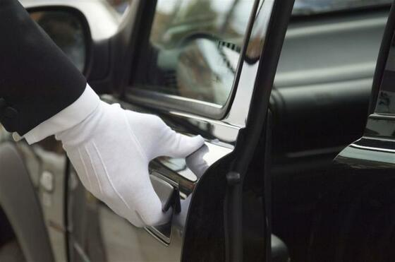 white gloved hand opening car door