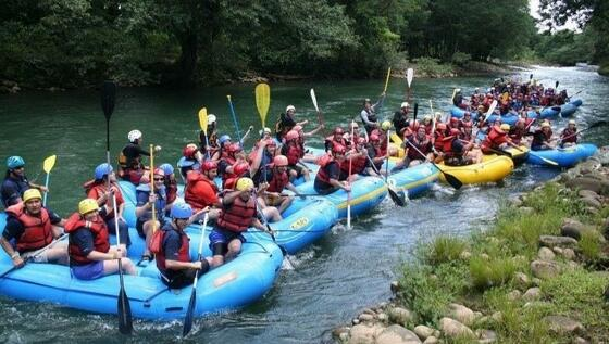 group of people water rafting