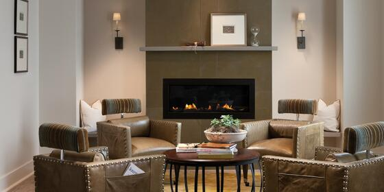 Living room and fireplace in hotel room