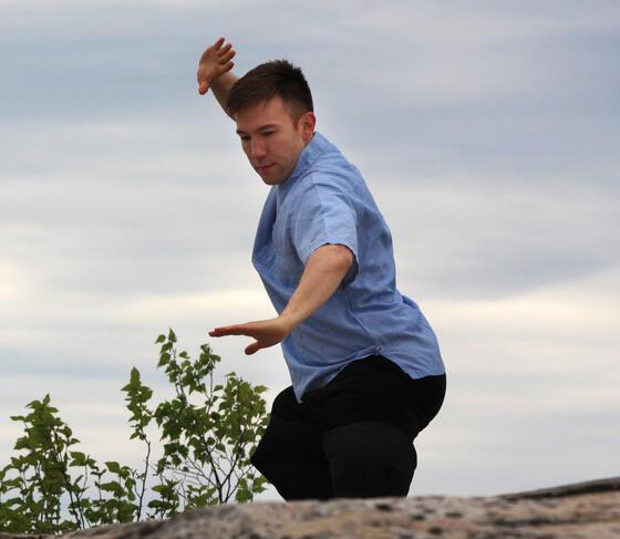 Man exercising on rock