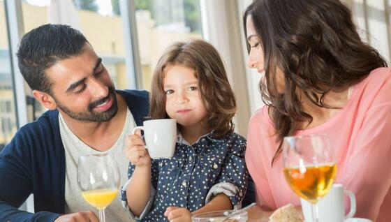 A Happy Family having breakfast - Monte Carlo Inn Airport Suites