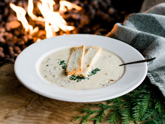 A bowl of soup served with bread at Alderbrook Resort & Spa
