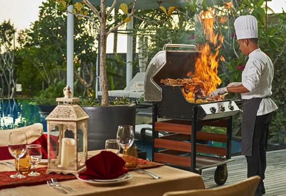 Chef grilling  food items at The Danna Langkawi