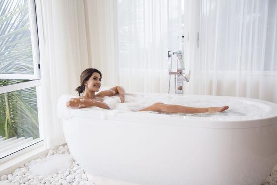 woman bathing in tub
