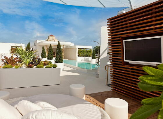 Roof top cabana sunbed pool & lounge at Dream South Beach