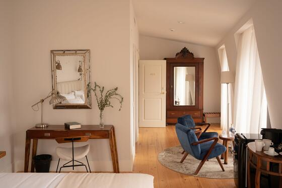 Hotel Alegria bedroom with desk, accent chairs and wardrobe clos