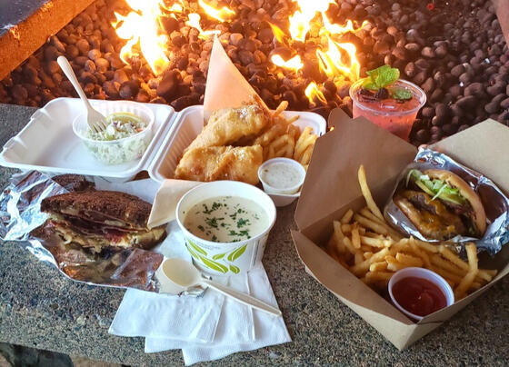 Variety of takeaway dishes served by the firepit in the Resort