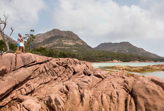 Couple at the rock in Freycinet Lodge