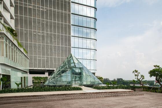 The triangular glass entrance in Vasa Hotel Surabaya