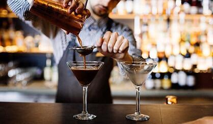 bartender preparing drinks at Hazards Bar at Freycinet Lodge