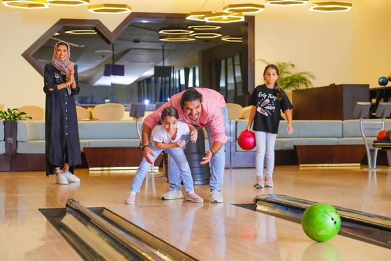 A family bowling at Bay La Sun Hotel & Marina