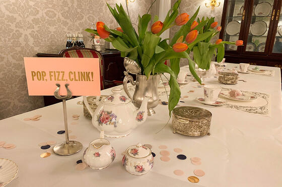 Decorated event table with sign reading