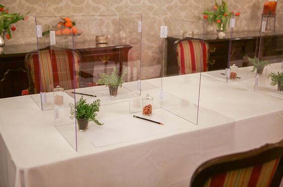 Table with clear plastic dividers for meeting event