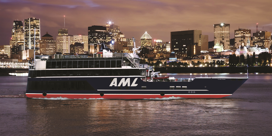 AML Cruises cruise ship at night.