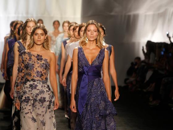 Women walking down runway