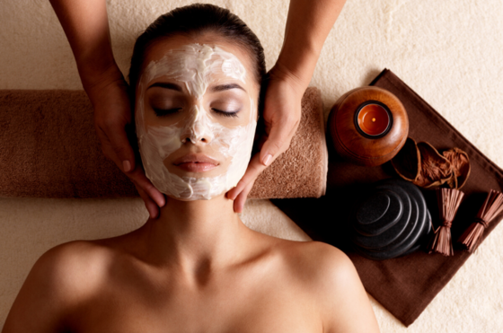 lady with facial mask having a massage