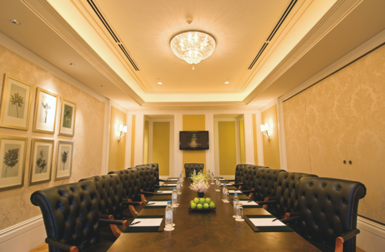 Boardroom furnished with long table and chairs