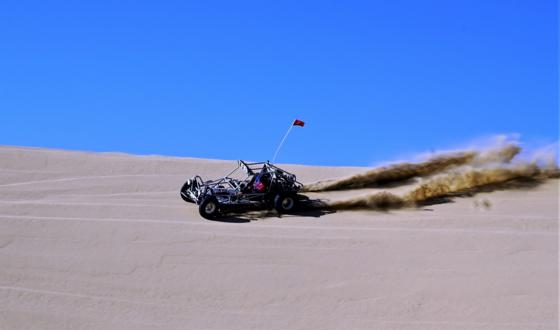 a go cart on sand dunes