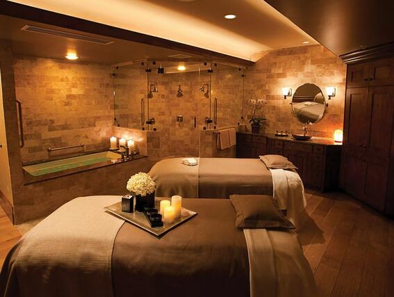 massage tables next to a bath tub