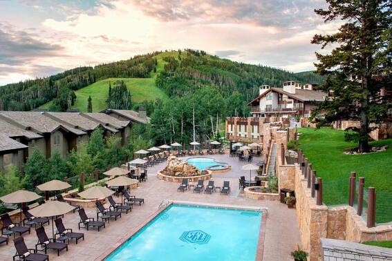 a pool and hot tub at a lodge