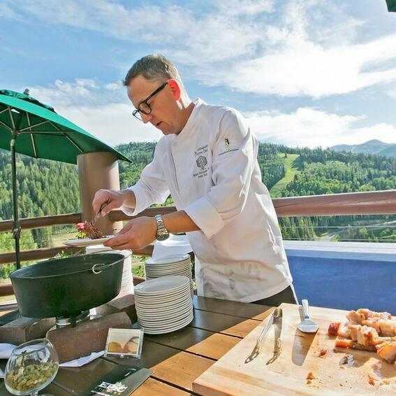 a chef preparing food in a skillet