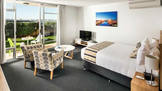 Bedroom with one bed in an apartment at Be Fremantle
