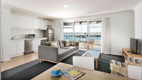 Living area and pantry area in an apartment at Be Fremantle