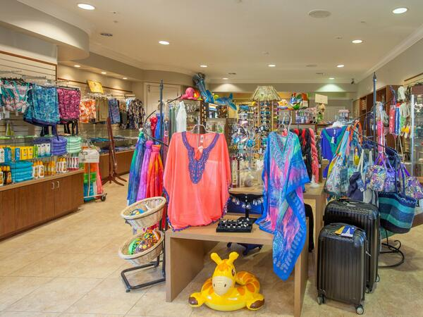 Clothing and travel items in shop