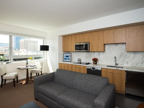 Suite living area and kitchenette with small table and chairs