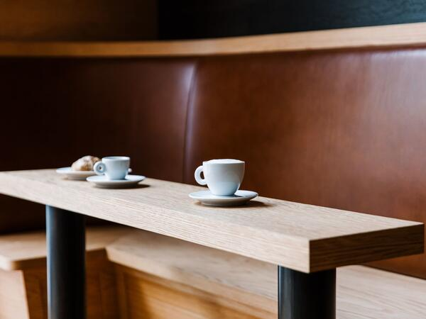 Booth seating and coffee mugs on table