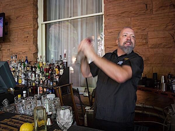 Bartender mixing drink