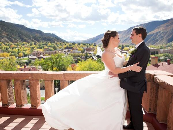 Bride and groom on balcony