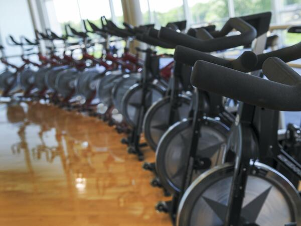 Photo of spinning bikes in fitness center
