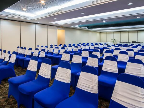 Linen covered chairs in meeting space set theater style