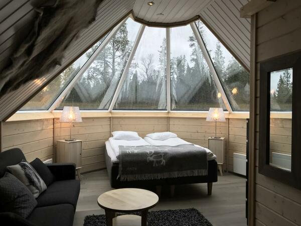 Glass-roof cabins at Northern Lights Village in Saariselkä, Lapl